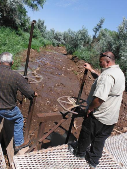 Rio Arriba County emergency manager Mateo DeVargas (right) surveys damage to a 400-foot stretch of the entrance to the Tierra Azul acequia with acequia Mayordomo Lucas Cordova. Many ditches along the lower Rio Chama were damaged by the high runoff.